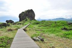 Wooden board walk at San Xian Tai isle in Taiwan Stock Image