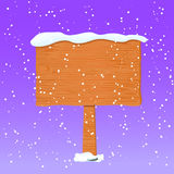 Wooden Board in White Snow Stock Photography