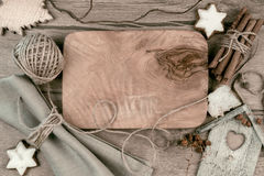 Wooden board with winter decorations around, text space Stock Photography
