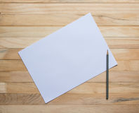Wooden boards and blank paper Stock Images