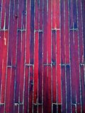 Wooden boards on boat. Colorful wooden boards on boat providing an abstract textured background in shades of purple, red and blue Stock Photos