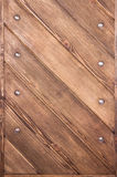 Wooden boards with bolts. Strong wooden boards are joined with metallic bolts Stock Image