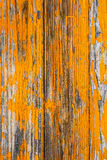 Wooden boards covered with peeling orange paint Royalty Free Stock Photos