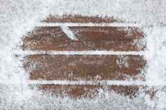 Wooden boards covered with snow Stock Image