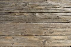 Wooden boards forming a rustic floor. Background, surface, texture, old, design, brown, vintage, frame, panel, plank, table, aged, natural, space, abstract stock photos