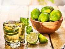 On wooden boards is glass with green mohito drink. Stock Image