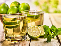 On wooden boards is glass with green mohito drink. Royalty Free Stock Images