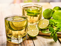 On wooden boards is glass with green transparent drink. Stock Images