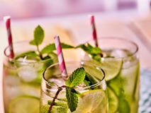 On wooden boards is glasses with mohito and knife. Stock Image
