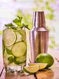 On wooden boards is glasses with mohito and knife. Stock Images