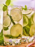 On wooden boards is glasses with mohito and lime. Stock Photography