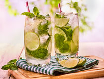 On wooden boards is glasses with mohito and napkin. Stock Image