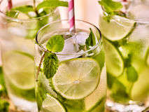 On wooden boards glasses with mohito and scoop ice. Stock Images