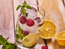 Wooden boards is glasses with raspberry mojito and cubes ice. Royalty Free Stock Photos