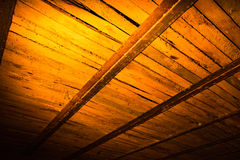 Wooden boards in golden lighting as background Stock Photo