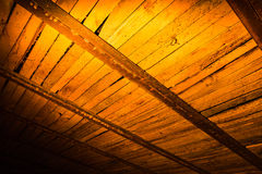 Wooden boards in golden lighting as background Royalty Free Stock Images