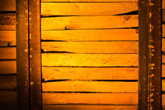 Wooden boards in golden lighting as background Stock Photos