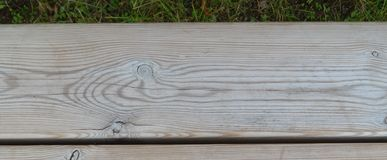 background of wooden boards. 2 and green grass above. Background royalty free stock photos