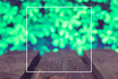 Wooden boards on a green spring background Royalty Free Stock Photos