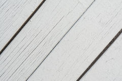 Wooden boards have a diagonal arrangement, painted with gray paint, visible wood texture and small cracks Stock Photo
