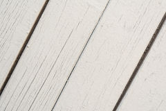 Wooden boards have a diagonal arrangement, painted with gray paint, visible wood texture and small cracks Stock Image