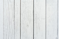 Wooden boards have a vertical arrangement, painted with gray paint, visible wood texture and small cracks Stock Photos