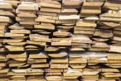 Wooden boards, lumber, industrial wood, timber. Building bar from a tree and an edging board in stacks stock image