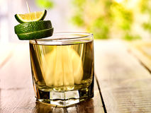 On wooden boards is mohito drink glass and half lime. Stock Image