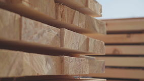 Wooden boards neatly stacked in neat rows. stock footage