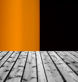 Wooden boards and orange black background Royalty Free Stock Images