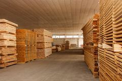 Wooden boards palletized in the workshop stock photography