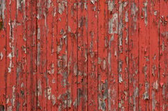 Wooden boards with peeling red paint Stock Images
