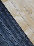 Wooden boards. In this picture we can see the diagonal wooden boards. The left half is dark and the right light Royalty Free Stock Photo