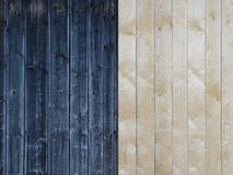 Wooden boards. In this picture we can see the vertical wooden boards. The left half is dark and the right light Stock Image