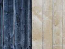 Wooden boards. In this picture we can see the vertical wooden boards. The left half is dark and the right light Royalty Free Stock Photography
