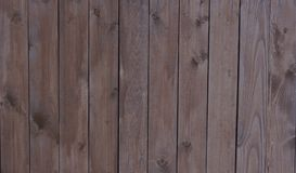Wooden boards pine a fence are covered with wood stain texture a. Background stock images