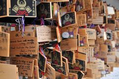 Wooden boards prayers Ema`s hanging in the Toshogu Shrine in Ueno Park, Tokyo stock photography