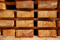 Wooden boards on racks. Royalty Free Stock Photos