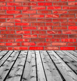 Wooden boards and red brick wall. Background of Wooden boards and red brick wall Stock Photography