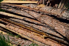 Wooden boards in the stack. The wooden boards shined with the sun close up Royalty Free Stock Photography