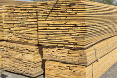 Wooden boards stacked in a pile Royalty Free Stock Image