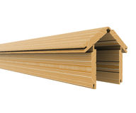 Wooden boards stacked in the shape of the house Royalty Free Stock Photography