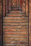 Wooden boards. Texture. Old wooden boards fixed by screws. It is a fragment of a door royalty free stock images