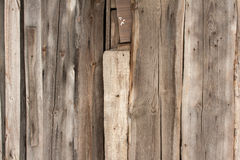 Wooden boards texture with traces of the old lattice Royalty Free Stock Photo