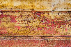 Wooden boards with traces of old yellow, red and orange paint, texture stock image