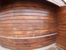 Wooden boards wall with wide angle fisheye view. Brown wall made of wooden boards with wide angle fisheye view stock image