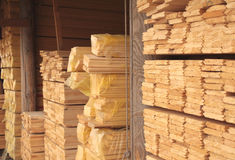 Wooden boards in a warehouse Stock Images