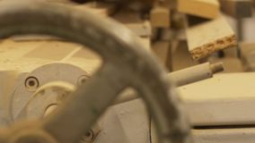 Wooden boards and woodworking machine at workshop. Production, manufacture and woodworking industry concept - wooden boards and old machine at workshop stock footage