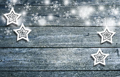 Wooden boards with Xmas decoration. Textured wooden boards with illustrated Xmas star shapes and lovely snowflakes, copy space background. Christmas and New Year Royalty Free Stock Photography