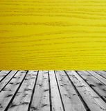 Wooden boards and yellow wood. Background of wooden boards and yellow wood Royalty Free Stock Images